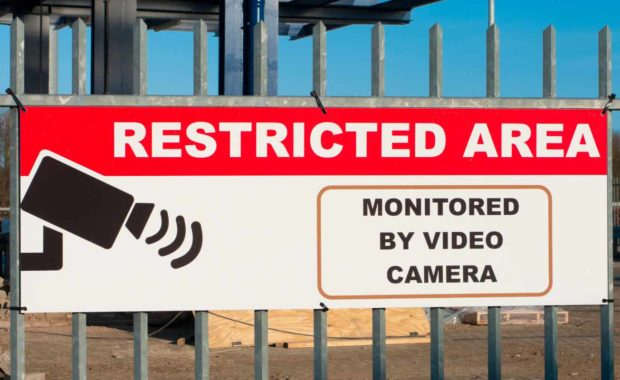 a-construction-site-with-a-restricted-area-sign-monitored-by-video-camera
