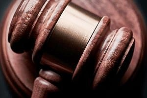 a hammer in a courtroom during an employee theft prosecution