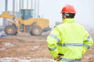 A construction site security is watching building works on site. It is important to have job site security.