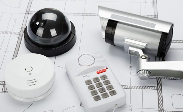 Business security alarm system equipment on a architectural blueprint