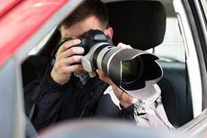 Private investigators taking pictures