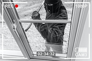burglar breaking into a home that can be prevented with chico city ca residential security services