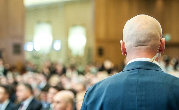 A Security guard during a business meeting. Depending on the types of event, cost of hiring security also vary