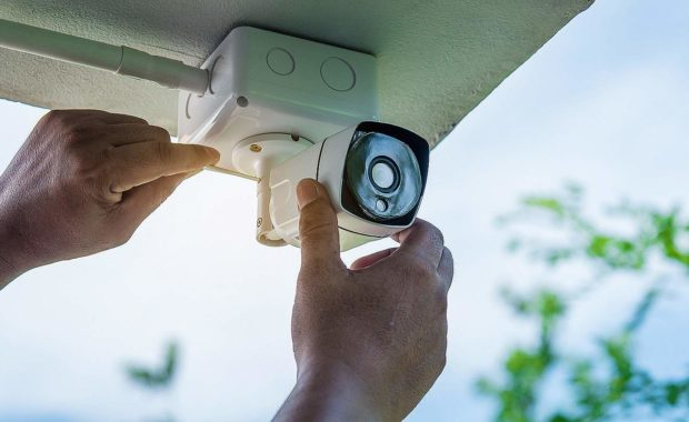 A technician installing a home security camera system