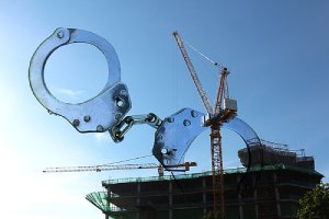 Conceptual image for construction site crimes. Construction site security guards protect the premises