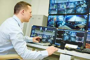 Corporate security agent monitoring surveillance security system