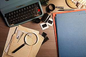 Private investigation's desk with confidential documents
