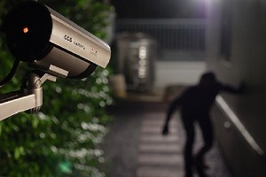 Security camera capturing intruder break into corporate building
