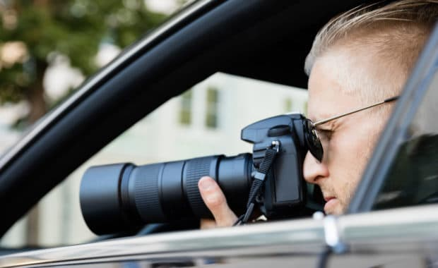 private detective takes photos for the investigation