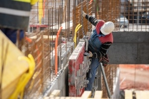man on dangerous building showing the need for Construction Site Security Plan