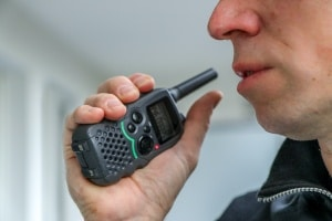 Walkie talkie being used by a Construction site security guards