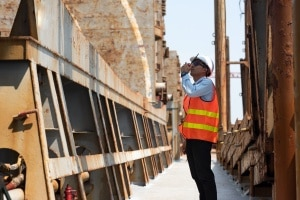 Construction site security guards talking on device