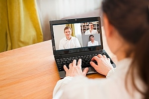 employee on a video call during a pandemic