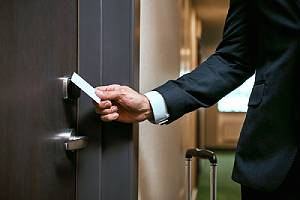 Hotel guest entering his room. Security is among the top concerns of many guests when choosing where to stay