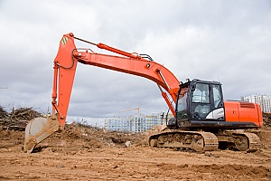 an excavator at a construction site that is protected by a Florida security company