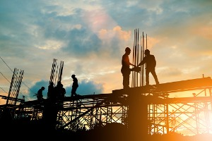 silhouette-of-engineer-and-construction-team-working-at-site-protected-by-security