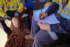 Inspector reviewing construction safety requirements checklist