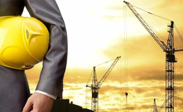 Construction Security Cost- Engineer Holding Yellow Helmet