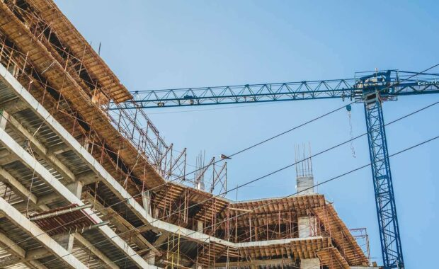 Hire Security During Construction For A Hotel- Crane Working in Construction