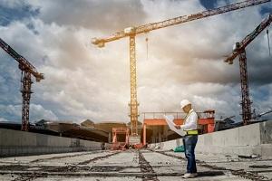 construction engineer in hardhat on Site under development
