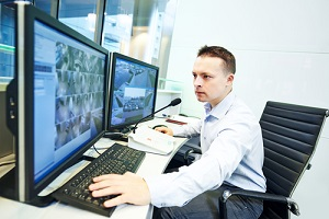 security guard officer watching video monitoring surveillance security system
