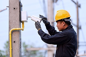 a construction site security camera being installed by a professional