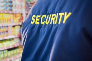 digital composite of security guard in the supermarket
