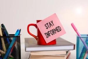 stay informed sticky note on coffee mug